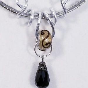 Aluminum Silver Spiral Pendant Tan Black Bead